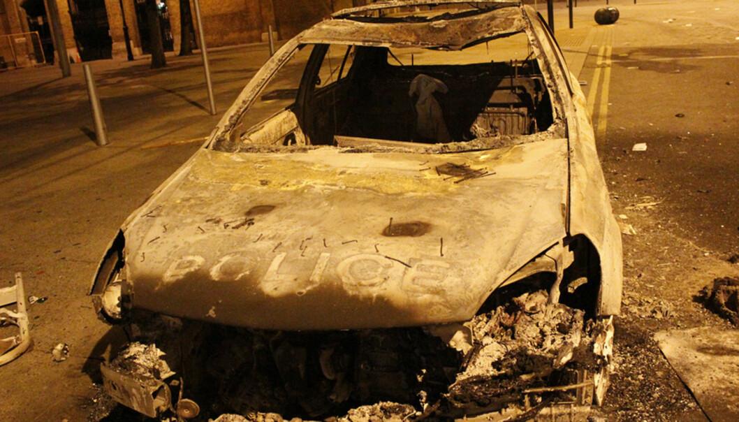 Ødeleggelsene etter opprørene i London i fjor var betydelige. Dette bildet viser en utbrent bil i Woolwich. Illustrasjonsfoto: Greg_Brummel/Flickr