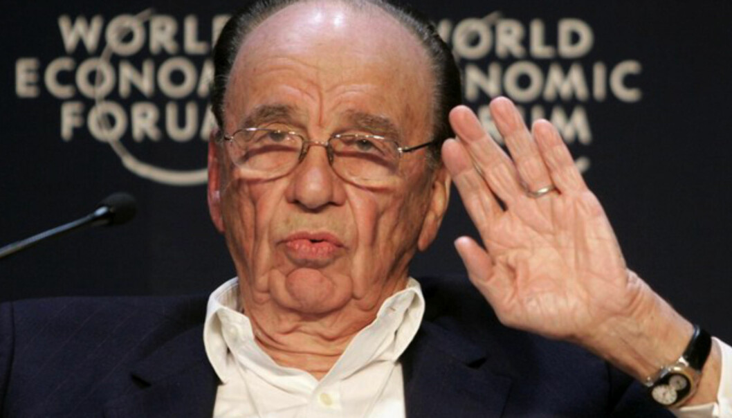 Media tycoon Rupert Murdoch addresses a session of the World Economic Forum (WEF) in Davos January 24, 2008.   REUTERS/Denis Balibouse   (SWITZERLAND)20100603