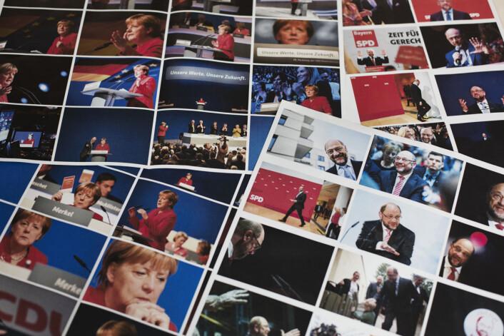 Michael Pfister går gjennom et knippe nye bilder av Angela Merkel, og hennes utfordrer fra SPD, Martin Schulz. Foto: Andrea Gjestvang