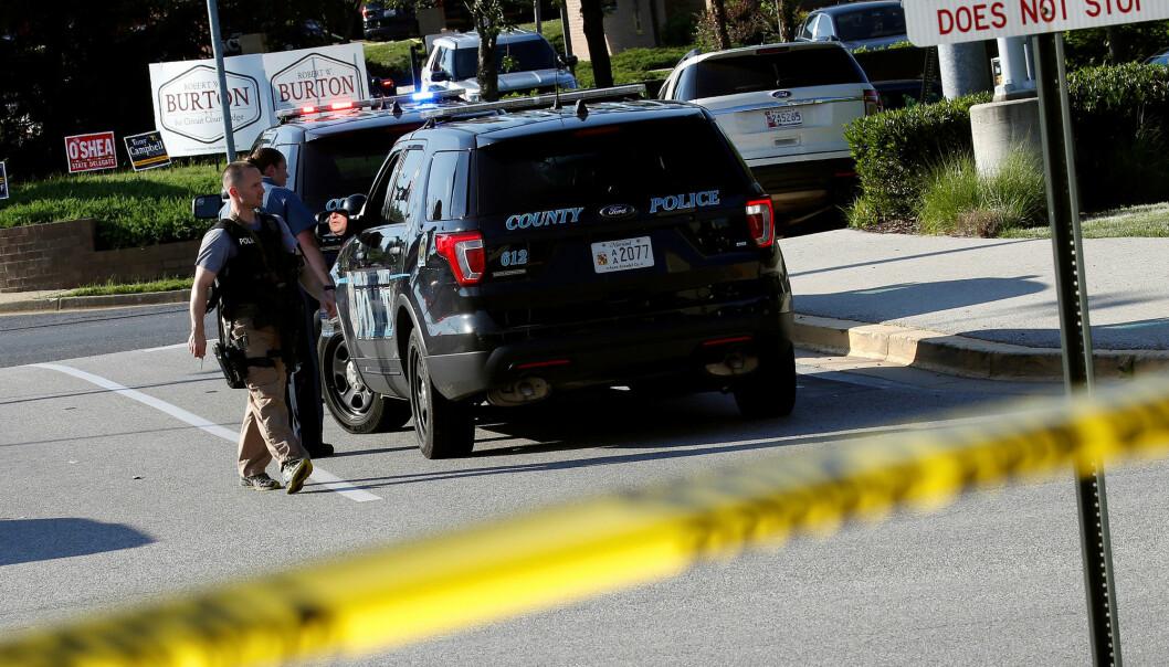 Politiet kom raskt til stedet da meldingene om skyting i avisen The Capital Gazette kom inn. Foto: Reuters / NTB scanpix