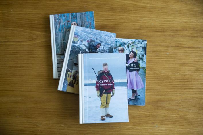 Lofotfisket, Vestregata, Væran og Longyearbyen er de fire bøkene utgitt av Agalaus så langt, både på norsk og på engelsk. Foto: Kristine Lindebø