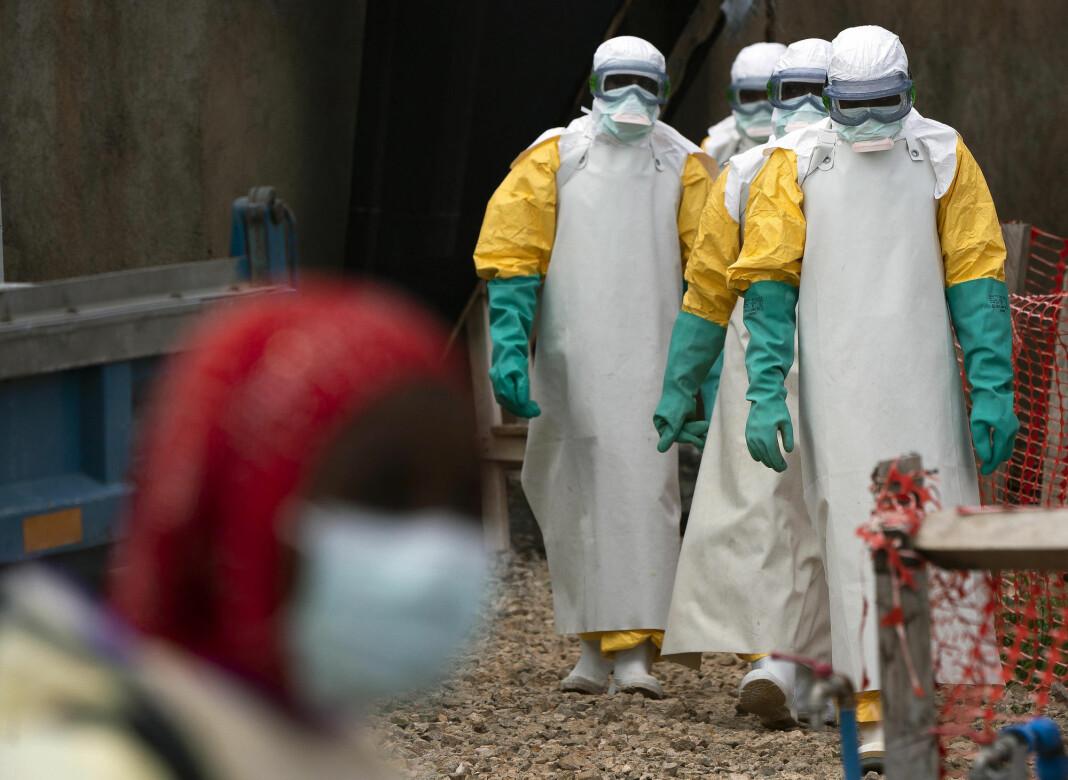 Arkivbilde av helsearbeideres om arbeider ved en helsestasjon som behandler ebolarammede i Beni i Kongo DRC. Foto: Jerome Delay/ AP/ NTB scanpix