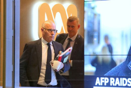 John Lyons (L), Executive Editor of ABC News, is followed by an Australian Federal Police officer as they walk out the main entrance to the ABC building located at Ultimo in Sydney, Australia, June 5, 2019. Picture taken June 5, 2019.  AAP Image/David Gray/via REUTERS    ATTENTION EDITORS - THIS IMAGE WAS PROVIDED BY A THIRD PARTY. NO RESALES. NO ARCHIVE. AUSTRALIA OUT. NEW ZEALAND OUT. NO COMMERCIAL OR EDITORIAL SALES IN NEW ZEALAND. NO COMMERCIAL OR EDITORIAL SALES IN AUSTRALIA.