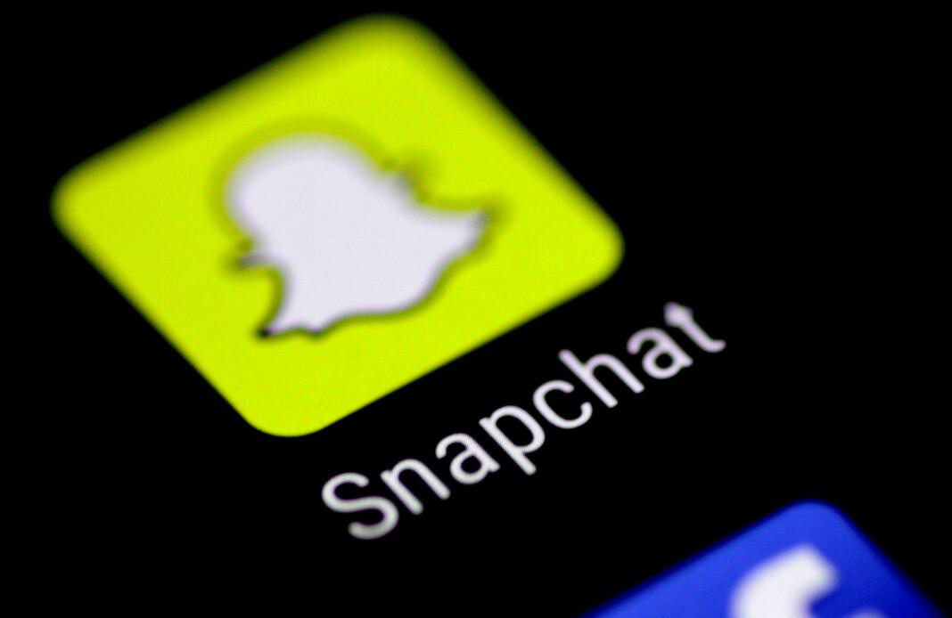 Snapchat-ikon på en mobiltelefon. Selskapet begrenser nå president Donald Trumps rekkevidde i sin tjeneste.